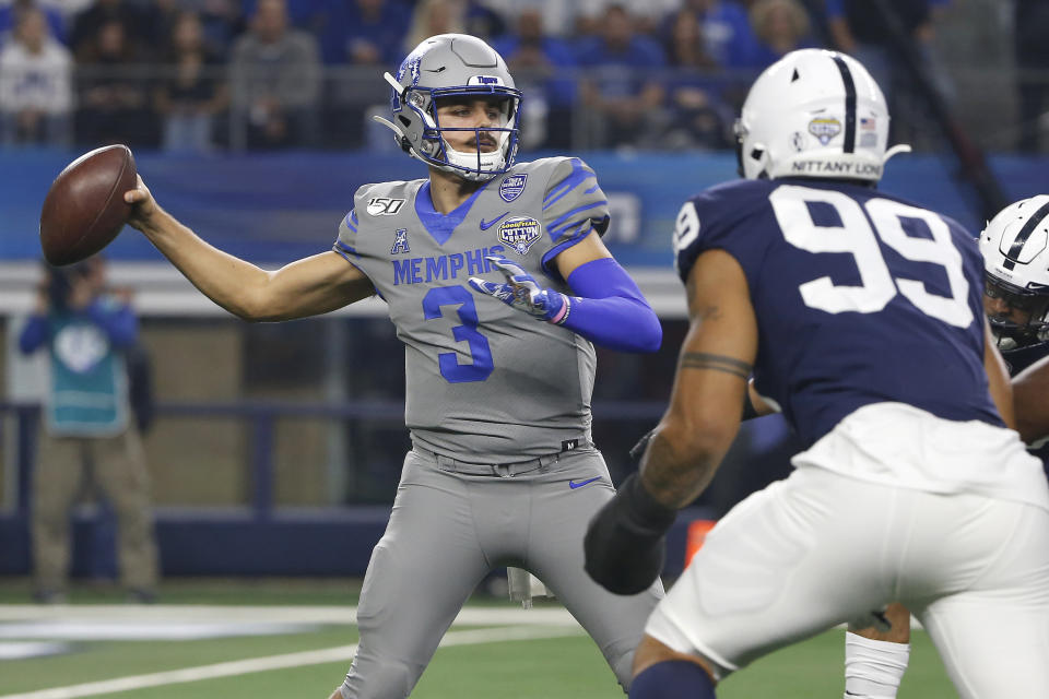Memphis quarterback Brady White (3) looks to throw as Penn State defensive end Yetur Gross-Matos (99) closes in during the first half of the NCAA Cotton Bowl college football game, Saturday, Dec. 28, 2019, in Arlington, Texas. (AP Photo/Ron Jenkins)