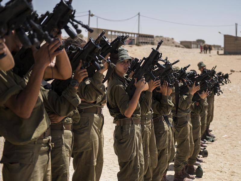 The ranges are offering tourists the chance to behave like IDF fighters (pictured): Ilia Yefimovich/Getty Images