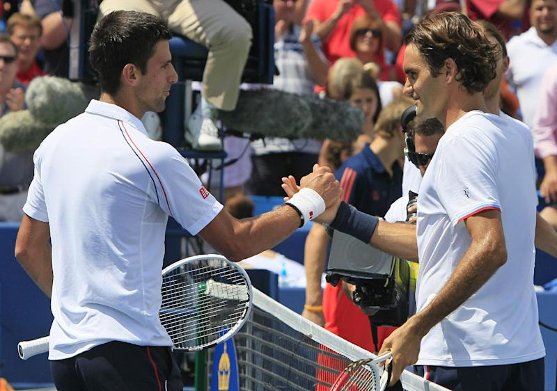 Novak Djokovic, left, from Serbia, congratulates Roger Federer, from Switzerland, after the men's final at the Western & Southern Open tennis tournament on Sunday, Aug. 19, 2012, in Mason, Ohio. Federer won 6-0, 7-6 (7). (AP Photo/Al Behrman)