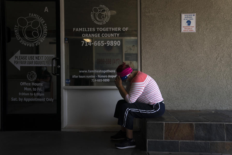 Ana Aguirre, 50, who said she was experiencing COVID-19 symptoms, waits to get tested for the virus at Families Together of Orange County Thursday, Aug. 26, 2021, in Tustin, Calif. (AP Photo/Jae C. Hong)