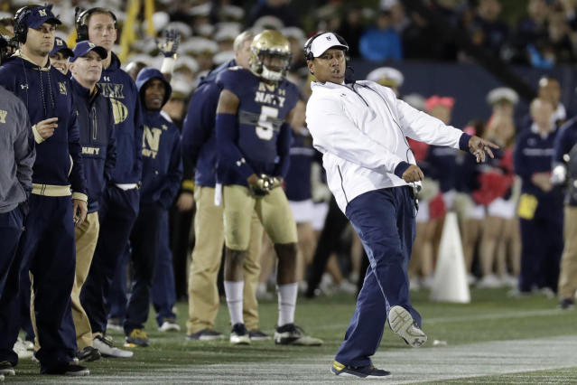 FILE - In this Oct. 22, 2016, file photo, Navy head coach Ken Niumatalolo, right, reacts as he watches a failed field goal-attempt in the second half of an NCAA college football game against Memphis, in Annapolis, Md. The 120th Army-Navy game is set for Saturday in Philadelphia. Navy leads the series 60-52-7. (AP Photo/Patrick Semansky, File)