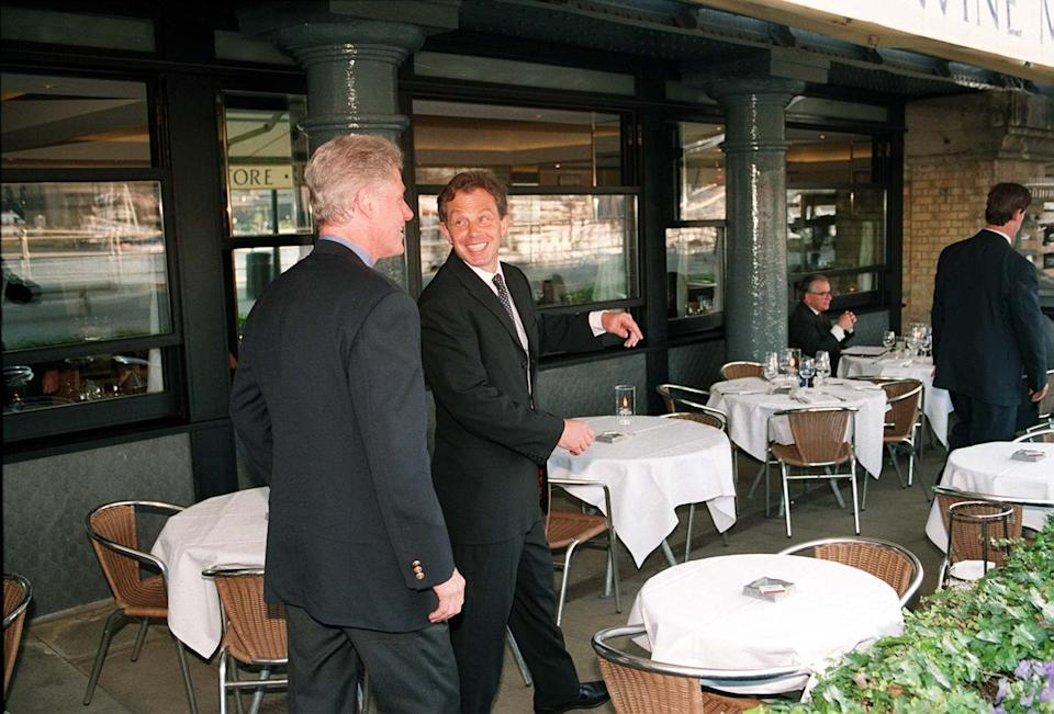 Embargoed to 0001 Tuesday July 20 File photo dated 29/05/1997 of US President Bill Clinton (left) and British Prime Minister Tony Blair at the Le Pont de la Tour restaurant in London. Clinton turned down tea at the Palace with the Queen in 1997 and told aides he wanted