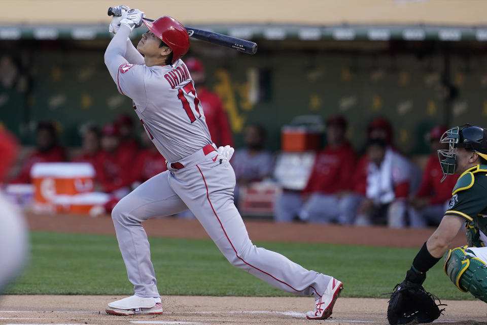 Los Angeles Angels designated hitter Shohei Ohtani (17) flies out against the Oakland Athletics during the first inning of a baseball game in Oakland, Calif., Monday, July 19, 2021. (AP Photo/Jeff Chiu)