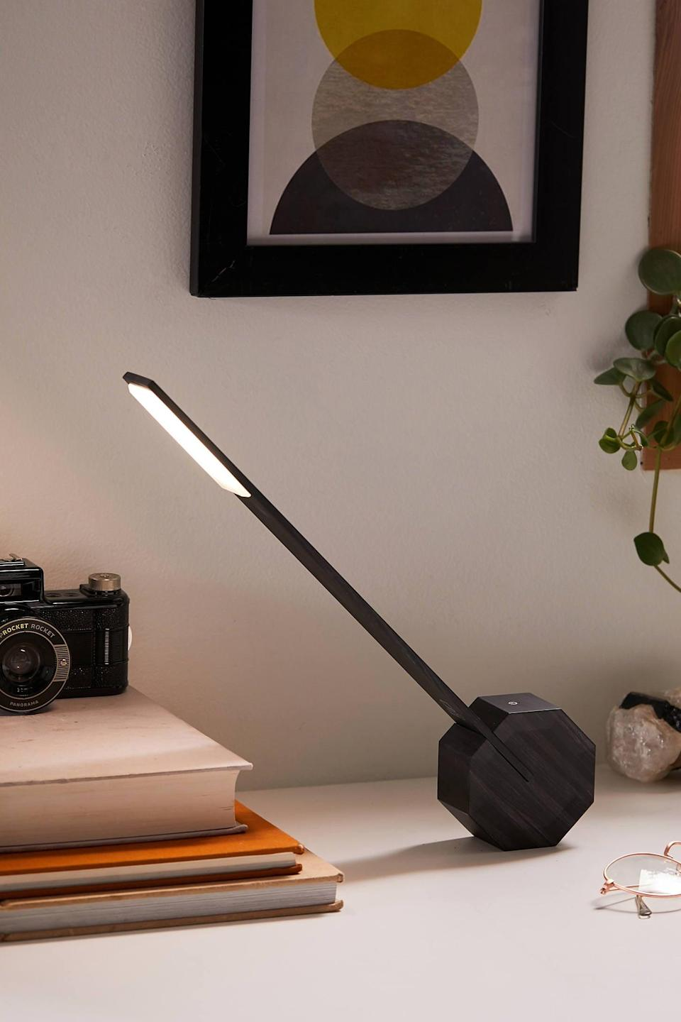 """<p>Wireless with a modern design, you can't go wrong with the <a href=""""https://www.popsugar.com/buy/Gingko-Octagon-One-Desk-Lamp-545916?p_name=Gingko%20Octagon%20One%20Desk%20Lamp&retailer=urbanoutfitters.com&pid=545916&price=79&evar1=geek%3Aus&evar9=36026397&evar98=https%3A%2F%2Fwww.popsugar.com%2Ftech%2Fphoto-gallery%2F36026397%2Fimage%2F47175967%2FGingko-Octagon-One-Desk-Lamp&list1=gifts%2Cgift%20guide%2Cdigital%20life%2Ctech%20gifts%2Cgifts%20for%20men&prop13=api&pdata=1"""" class=""""link rapid-noclick-resp"""" rel=""""nofollow noopener"""" target=""""_blank"""" data-ylk=""""slk:Gingko Octagon One Desk Lamp"""">Gingko Octagon One Desk Lamp</a> ($79).</p>"""