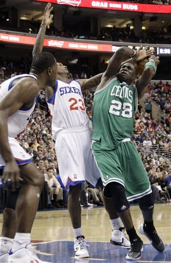 Boston Celtics' Mickael Pietrus (28), of France, collides with Philadelphia 76ers' Lou Williams (23) in the first half of an NBA basketball game on Friday, March 23, 2012, in Philadelphia. Pietrus was injured on the play. (AP Photo/Matt Slocum)