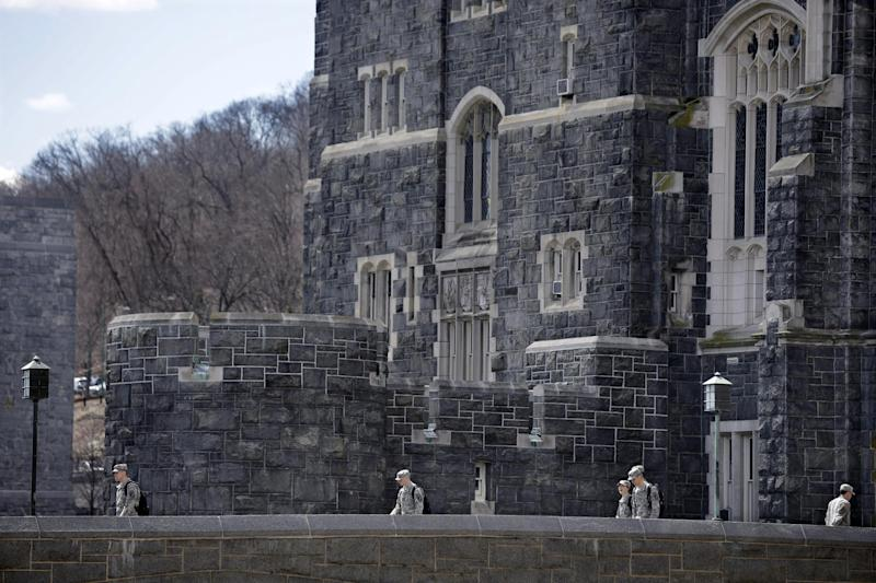In this April 9, 2014 photo, West Point cadets walk on campus during lunchtime break at the United States Military Academy in West Point, N.Y. With the Pentagon lifting restrictions for women in combat jobs, Lt. Gen. Robert Caslen Jr. has set a goal of boosting the number of women above 20 percent for the new class reporting this summer. (AP Photo/Mel Evans)