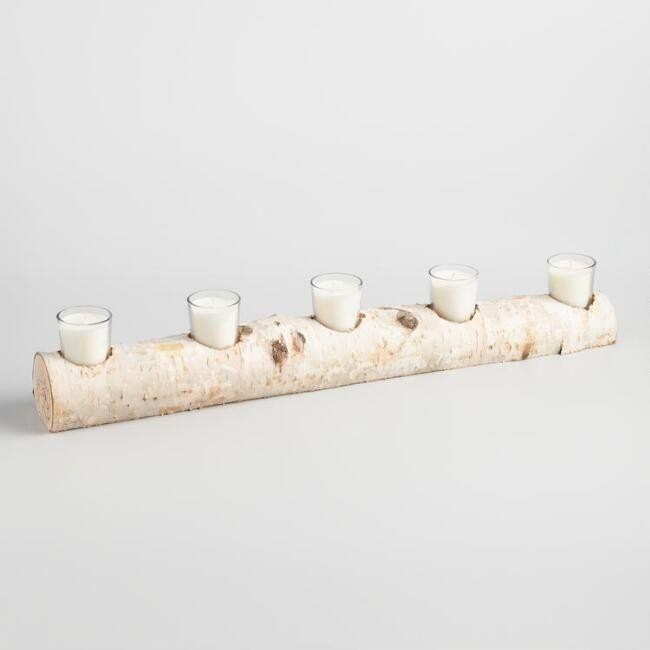 "Bring the woods without all of the creepy crawlers to your Thanksgiving table with this <a href=""https://www.worldmarket.com/product/5-votive-candle-birch-branch-centerpiece.do?sortby=ourPicks&from=fn"" target=""_blank"">birchwood centerpiece</a>."