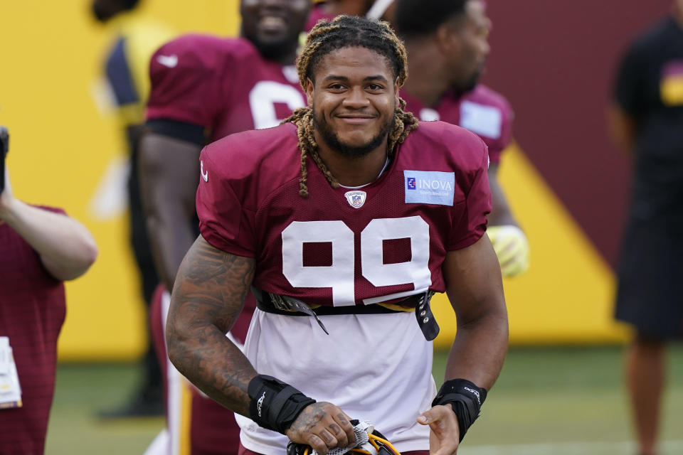 Washington Football Team defensive end Chase Young smiles during the NFL football team's practice Friday, Aug. 6, 2021, in Landover, Md. (AP Photo/Alex Brandon)