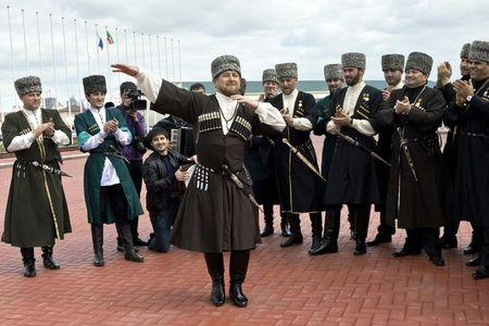 Chechen leader Ramzan Kadyrov (front), dressed in a national costume, performs during celebrations dedicated to the Chechen Language Day in Grozny, in Chechnya, Russia, in this April 25, 2011 file picture. REUTERS/Stringer/Files