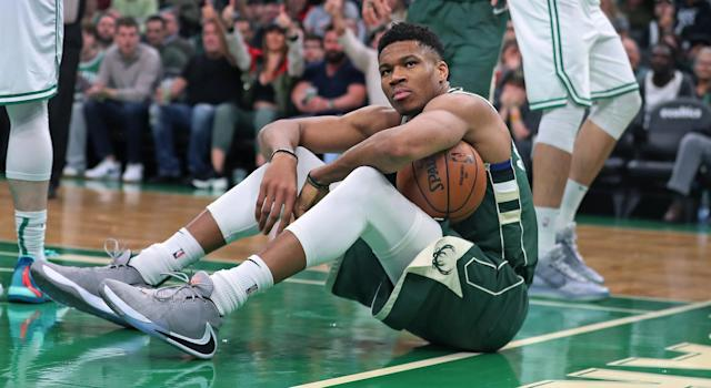 Don't let the mean mug fool you, because Giannis certainly digs his first signature shoe. (Photo by Jim Davis/The Boston Globe via Getty Images)