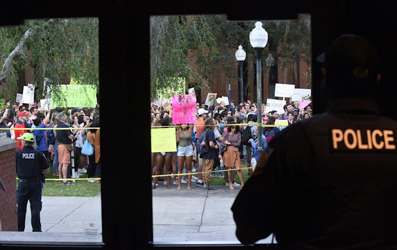 Police watch protesters before a speech by Trump Jr. and Guilfoyle, in what was billed as a keynote presentation. (Photo: SOPA Images via Getty Images)