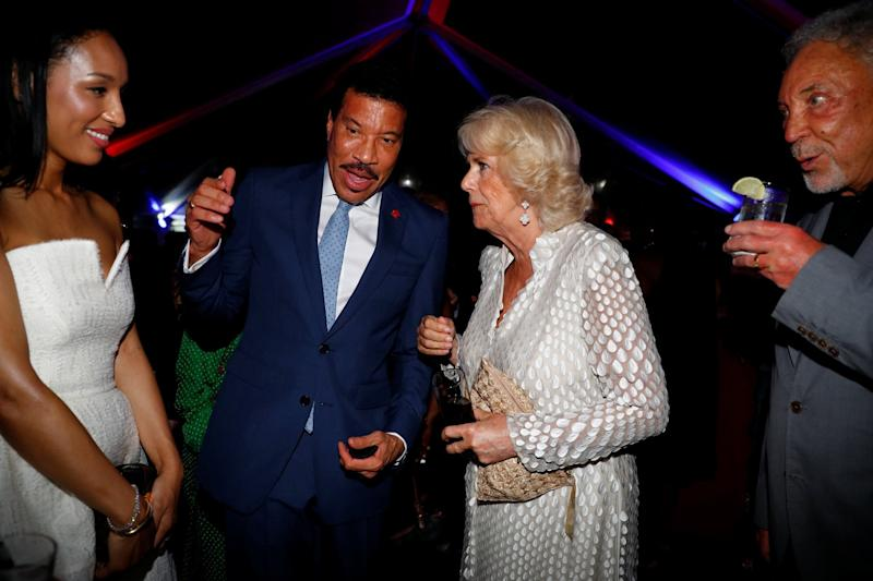 Hello: Camilla meets Lionel Richie on the royals' tour of the Caribbean (PA)
