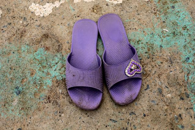 "A pair of sandals, worn by one of the children playing soccer, lie on the ground in the old city of Algiers Al Casbah, Algeria, May 5, 2018. REUTERS/Zohra Bensemra SEARCH ""FOOTBALL GLOBAL"" FOR THIS STORY. SEARCH ""WIDER IMAGE"" FOR ALL STORIES."