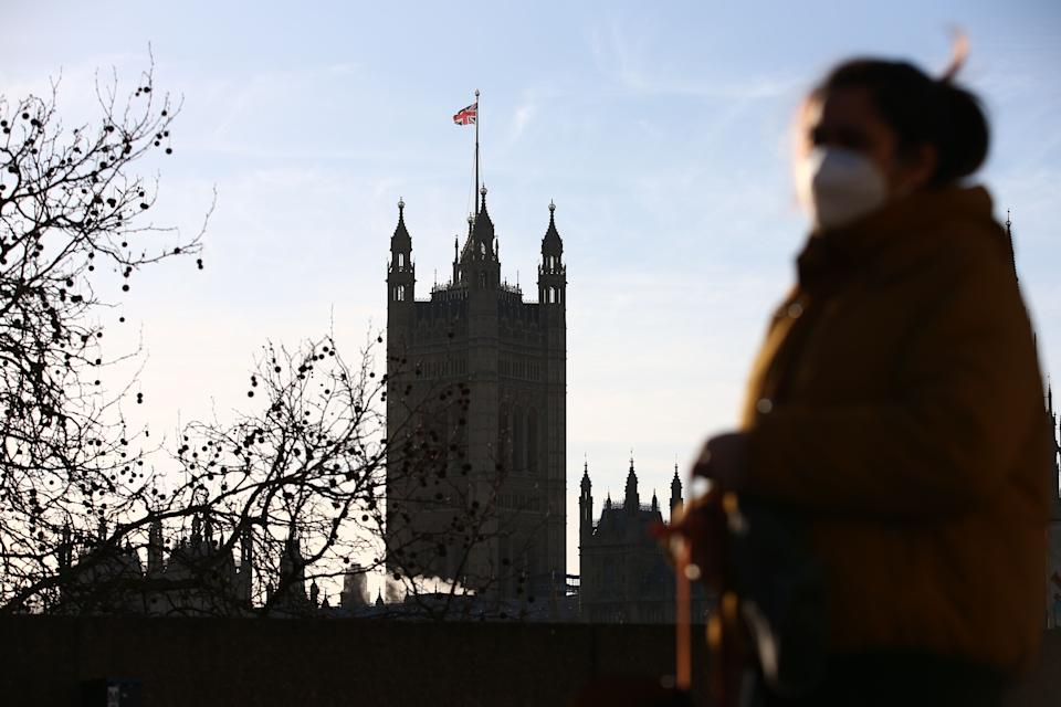 A pedestrian walks in central London with the Houses of Parliament in the background as data shows falling trust in government. Photo: Hollie Adams/AFP via Getty