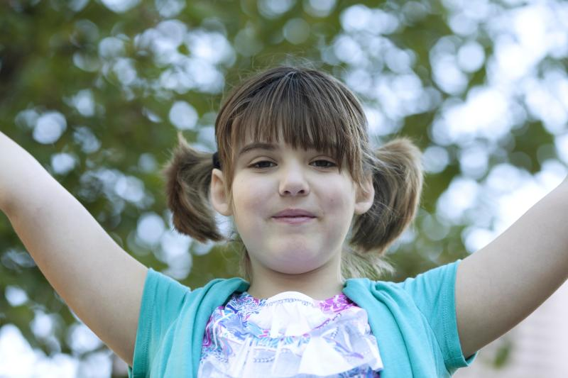 This Nov. 18, 2013 photo provided by the The Children's Hospital of Philadelphia shows Emily Whitehead, 8, 20 months after T Cell Therapy treatment in Philadelphia. In one of the biggest advances against leukemia and other blood cancers in many years, doctors are reporting unprecedented success by using gene therapy to transform patients' blood cells into soldiers that seek and destroy their cancer. (AP Photo/The Children's Hospital of Philadelphia, Ed Cunicelli)
