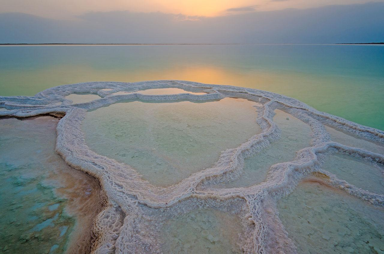 """<h2>The Dead Sea</h2>                                                                                                                                                                 <p><p>The next time you want to buy products boasting Dead Sea salts as among their ingredients, you may want to think twice. An increase in demand for these products and the use of the Dead Sea for its purported healing powers are<a rel=""""nofollow"""" href=""""http://www.forbes.com/pictures/emej45ldlg/dead-sea/#427776006d0b"""">among the reasons it's diminishingat an alarming rate</a>. (The biggest culprit, however, is diversion of the Jordan River.) You can see a pretty dramatic map of this depletion since the 1970s <a rel=""""nofollow"""" href=""""http://www.haaretz.com/st/c/prod/global/deadsea/eng/5/"""">here</a>. Sinkholes have also become a huge problem for the Dead Sea area—in 1996 there were 200, whereas today there are more than 5,000. Jordan is working on a project that will link the Red Sea with the Dead Sea and in doing so save the latter, but some <a rel=""""nofollow"""" href=""""http://siteresources.worldbank.org/EXTREDSEADEADSEA/Resources/ESAArchaeologySiteAssessmentReport_Part1.pdf"""">scientists</a> say this scenario will have dire consequences for the environment. As such, we suggest you see the sea sooner rather than later.</p>                                                                                                                                                                   <h4>Getty Images</h4>                                                                                                         <p>     <strong>Related Articles</strong>     <ul>         <li><a rel=""""nofollow"""" href=""""http://thezoereport.com/fashion/style-tips/box-of-style-ways-to-wear-cape-trend/?utm_source=yahoo&utm_medium=syndication"""">The Key Styling Piece Your Wardrobe Needs</a></li><li><a rel=""""nofollow"""" href=""""http://thezoereport.com/living/relationships/when-to-get-married/?utm_source=yahoo&utm_medium=syndication"""">Scien"""