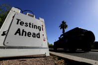 FILE - In this May 23, 2020, file photo, a vehicle arrives at COVID-19 testing site at Steele Indian School Park, in Phoenix. Coronavirus cases are rising in nearly half the U.S. states, as states are rolling back lockdowns. (AP Photo/Matt York, File)