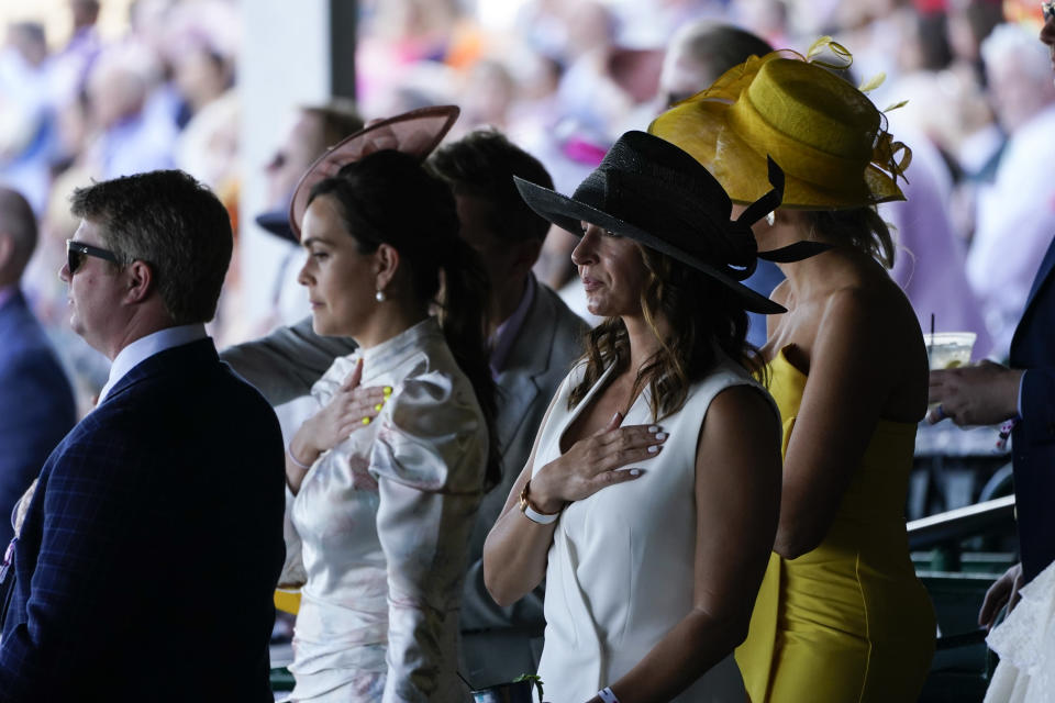 Fans stand for the national anthem before the 147th running of the Kentucky Derby at Churchill Downs, Saturday, May 1, 2021, in Louisville, Ky. (AP Photo/Charlie Riedel)