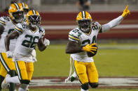 Green Bay Packers safety Raven Greene (24) celebrates after intercepting a pass against the San Francisco 49ers during the first half of an NFL football game in Santa Clara, Calif., Thursday, Nov. 5, 2020. (AP Photo/Tony Avelar)