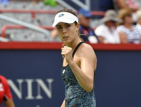 Aug 8, 2018; Montreal, Quebec, Canada; Alize Cornet of France reacts after a point against Angelique Kerber of Germany (not pictured) in the Rogers Cup tennis tournament at Stade IGA. Eric Bolte-USA TODAY Sports