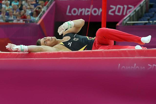 LONDON, ENGLAND - JULY 28: Philipp Boy of Germany falls off the horizontal bar in the Artistic Gymnastics Men's Team qualification on Day 1 of the London 2012 Olympic Games at North Greenwich Arena on July 28, 2012 in London, England. (Photo by Ronald Martinez/Getty Images)