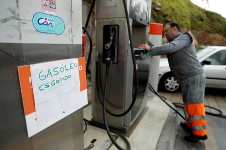 """A placard reading """"Diesel sold out"""" is seen at a gas station in Porto"""