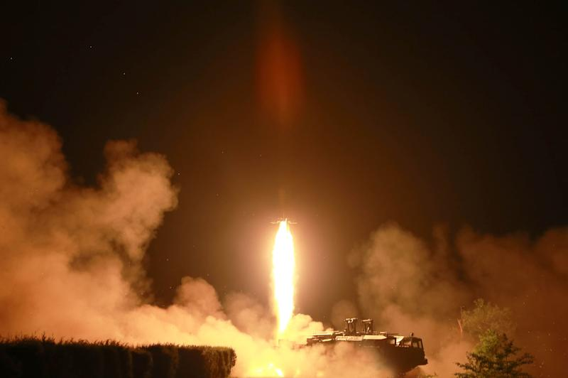 Undated photo released on July 10, 2014 shows a tactical rocket firing drill by the Korean People's Army Strategic Force in the western sector of the front
