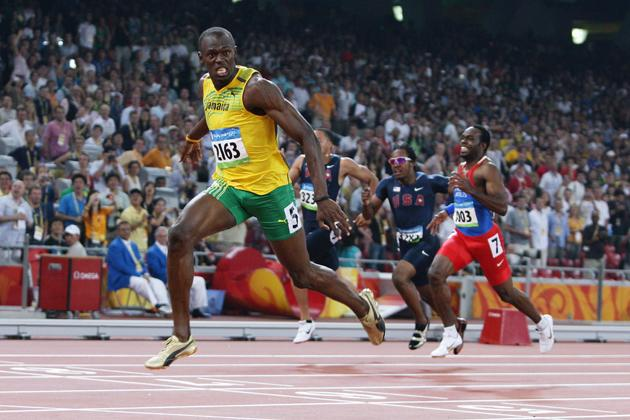 Usain Bolt of Jamaica reacts after breaking the world record with a time of 19.30 to win the gold medal in the Men's 200m Final at the National Stadium during Day 12 of the Beijing 2008 Olympic Games on August 20, 2008 in Beijing, China.  (Photo by Mark Dadswell/Getty Images)