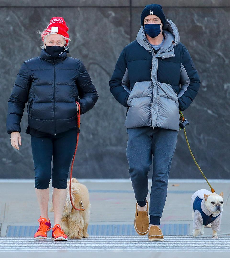 <p>Hugh Jackman and his wife Deborra-Lee Furness take their dogs for a walk by the Hudson River in N.Y.C. on Tuesday.</p>