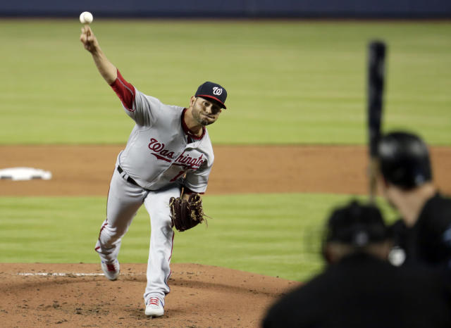 Washington Nationals starting pitcher Anibal Sanchez, left, delivers to Miami Marlins' Neil Walker, right, during the first inning of a baseball game, Friday, April 19, 2019, in Miami. (AP Photo/Lynne Sladky)