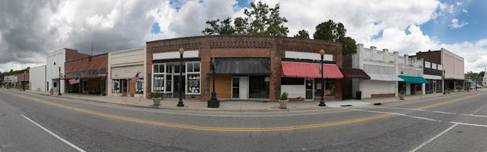 The business district of Fair Bluff, NC has been abandoned after the Lumber River flooded the businesses during Hurricanes Matthew in 2016 and Hurricane Florence in 2018 leaving several feet water in the buildings and rendering most unusable. This composite photograph was created using 11 still images.