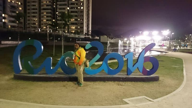 Claire Dawn-Marie Gittens poses with a Rio Olympics signage in Rio de Janeiro