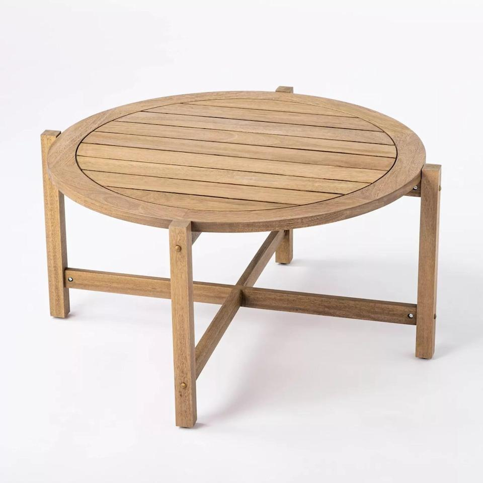 <p>The <span>Bluffdale Wood Patio Coffee Table</span> ($200) is the perfect height for food and drinks. </p>