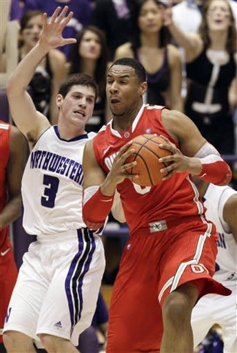 Ohio State forward Jared Sullinger (0) drives to the basket as Northwestern guard Omar Jimenez (3) guards during the first half of an NCAA college basketball game in Evanston, Ill., Wednesday, Feb. 29, 2012. (AP Photo/Nam Y. Huh)