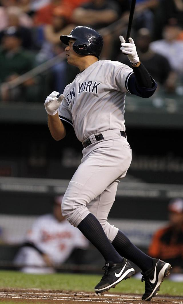 New York Yankees' Alex Rodriguez follows through on a solo home run to right field during the first inning of a baseball game against the Baltimore Orioles, Monday, Sept. 9 2013, in Baltimore. (AP Photo/Luis M. Alvarez)