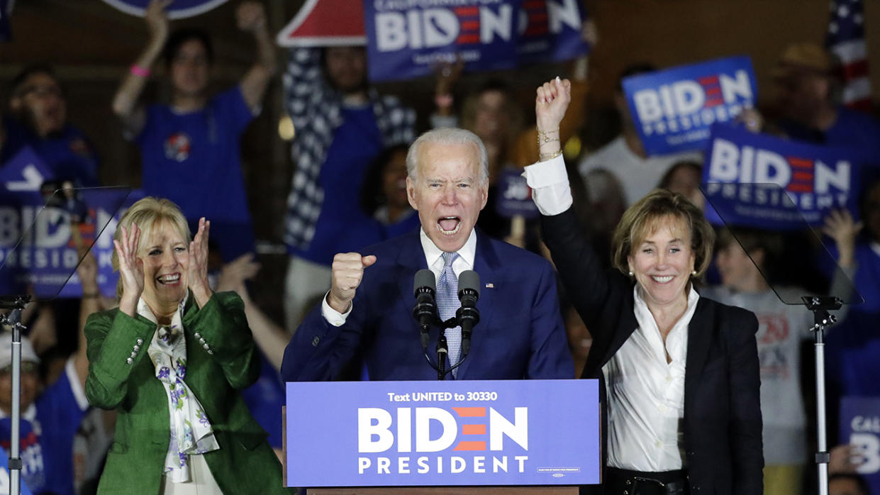 Joe Biden speaks at a primary election night campaign rally Tuesday, March 3, 2020, in Los Angeles with his wife Jill Biden, left, and his sister Valerie. (Chris Carlson/AP)