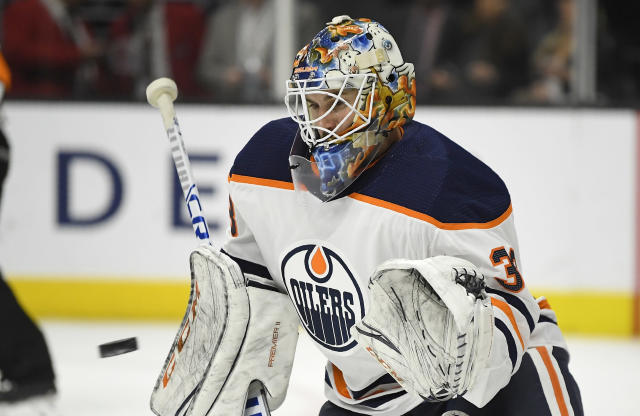 Edmonton Oilers goaltender Cam Talbot makes a glove save during the second period of the team's NHL hockey game against the Los Angeles Kings, Saturday, Feb. 24, 2018, in Los Angeles. (AP Photo/Mark J. Terrill)