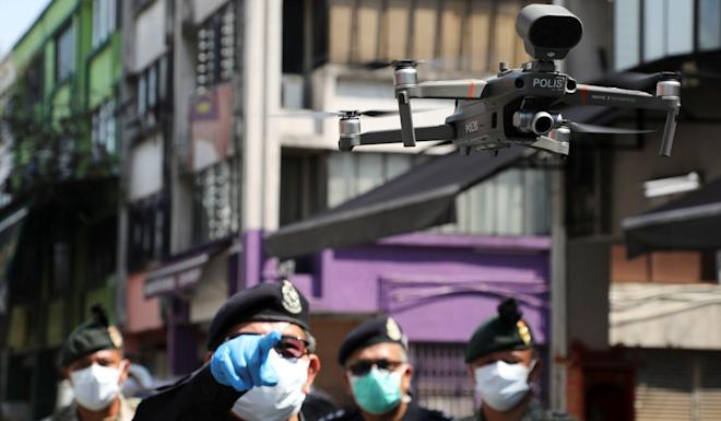 Police are using drones to remind citizens to stay at home during the movement control order due to the outbreak of the coronavirus in the capital Kuala Lumpur. Photo: Reuters