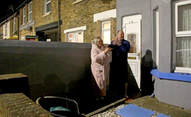 A couple outside their house in Dover, Kent, join in applause to salute local heroes during the nationwide Clap for Heroes event to recognise and support NHS workers and carers fighting the coronavirus pandemic in the latest lockdown