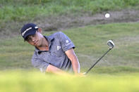Collin Morikawa chips onto the 17th green during the final round of the Workday Championship golf tournament Sunday, Feb. 28, 2021, in Bradenton, Fla. (AP Photo/Phelan M. Ebenhack)