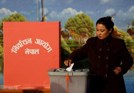 A woman casts her vote during the parliamentary and provincial elections in Bhaktapur, Nepal December 7, 2017. REUTERS/Navesh Chitrakar