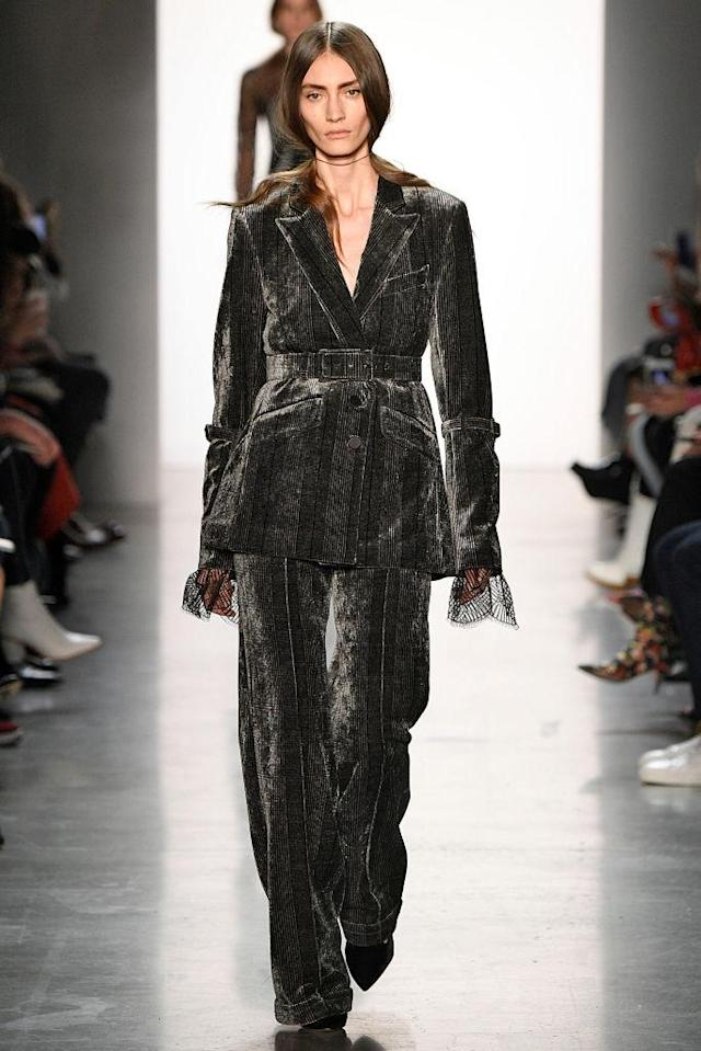 <p>Model wears a velvet gray pantsuit at the fall 2018 Jonathan Simkhai show. (Photo: Getty Images) </p>