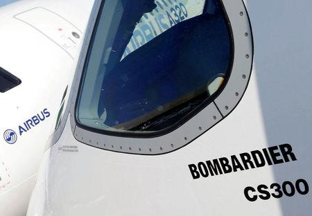 FILE PHOTO: An Airbus A320neo aircraft and a Bombardier CSeries aircraft are pictured during a news conference to announce a partnership between Airbus and Bombardier on the C Series aircraft programme, in Colomiers near Toulouse, France, October 17, 2017.  REUTERS/Regis Duvignau/File Photo