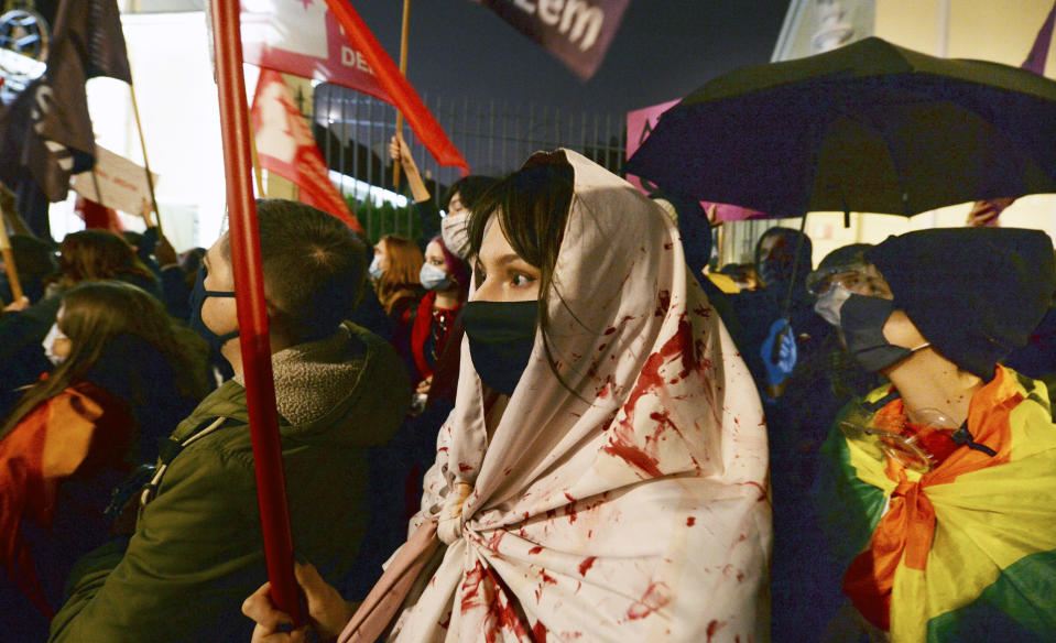 People protest against imposing further restrictions on abortion law in front of the Warsaw Curia in Warsaw, Poland, Sunday, Oct. 25, 2020. (AP Photo/Czarek Sokolowski)