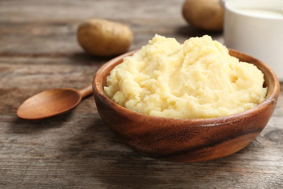 """<p>Potatoes are the recurring theme of Midwestern Christmas sides, and that means mashed potatoes are <a href=""""https://www.thedailymeal.com/best-holiday-pies-recipes?referrer=yahoo&category=beauty_food&include_utm=1&utm_medium=referral&utm_source=yahoo&utm_campaign=feed"""" rel=""""nofollow noopener"""" target=""""_blank"""" data-ylk=""""slk:essential for the holidays"""" class=""""link rapid-noclick-resp"""">essential for the holidays</a>. Chicken stock, sour cream, cheddar cheese and bacon put a spin on a standard dish.<br><br><em><a href=""""https://www.thedailymeal.com/recipes/loaded-mashed-potatoes-recipe?referrer=yahoo&category=beauty_food&include_utm=1&utm_medium=referral&utm_source=yahoo&utm_campaign=feed"""" rel=""""nofollow noopener"""" target=""""_blank"""" data-ylk=""""slk:For the Loaded Mashed Potatoes recipe, click here."""" class=""""link rapid-noclick-resp"""">For the Loaded Mashed Potatoes recipe, click here.</a></em></p>"""