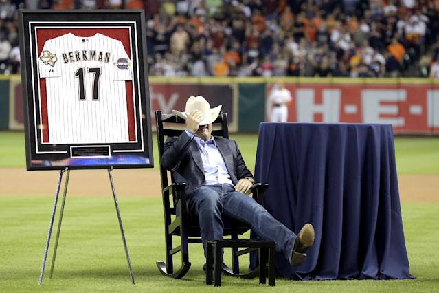 Former Houston Astros player Lance Berkman sits back in his rocking chair during a ceremony to recognize his contributions to the team before a baseball game against the Los Angeles Angels, Saturday, April 5, 2014, in Houston. Berkman and former teammate Roy Oswalt signed one-day personal services contracts so they could retire as Astros. Each received a World Series jersey, a Stetson and a personalized rocking chair. (AP Photo/Pat Sullivan)