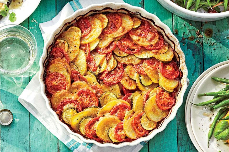 """<p><b>Recipe: <a href=""""https://www.southernliving.com/syndication/zucchini-potato-casserole"""" rel=""""nofollow noopener"""" target=""""_blank"""" data-ylk=""""slk:Zucchini-Potato Casserole"""" class=""""link rapid-noclick-resp"""">Zucchini-Potato Casserole</a></b></p> <p>Find a prettier potato bake, we challenge. This layered vegetable bake stands out on any spread. </p>"""