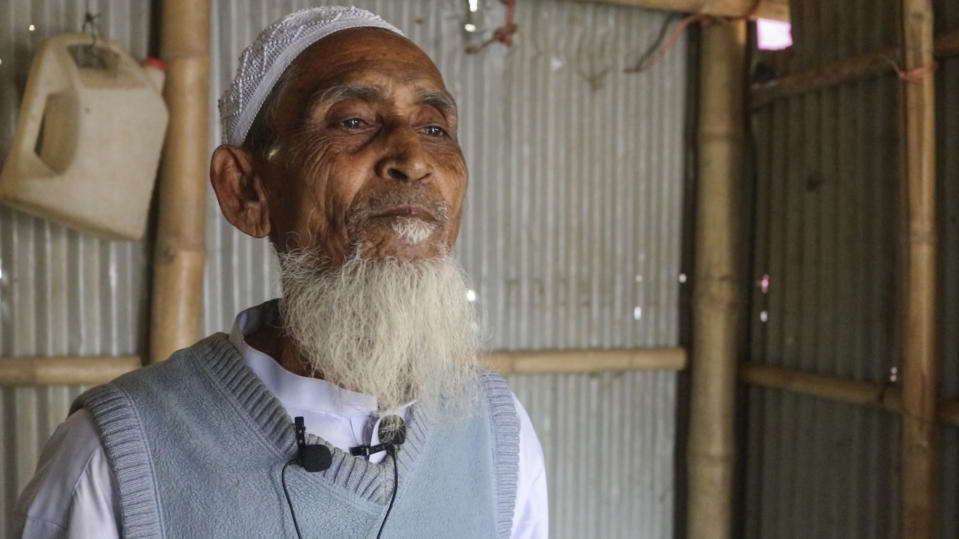 """Rohingya refugee Mohammad Jaffar, 70, talks to the Associated Press at the Balukhali refugee camp in Cox's Bazar, Bangladesh, Tuesday, Feb.2, 2021. Rohingya refugees from Myanmar living in camps in Bangladesh are condemning the military coup in their homeland and saying it makes them more fearful to return. """"Repatriation will not be safe at all under this regime because the very people who are responsible for killing, torturing, raping, our mothers and sisters, have now come in power. After all this suffering we ran and came here. Now if we go back into the hands of people who are responsible for our torture, we will probably have to bear twice as much pain as before."""", Jaffar said.(AP Photo/Shafiqur Rahman)"""
