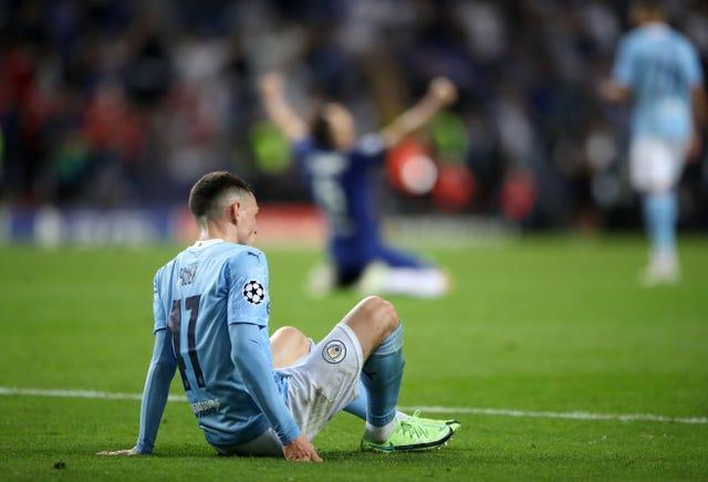 Phil Foden appears dejected at the final whistle after defeat to Chelsea in the Champions League final