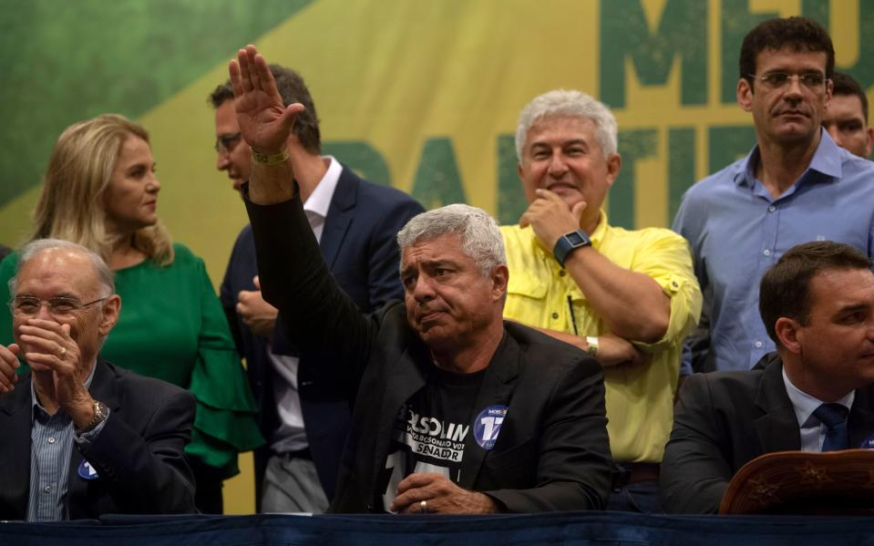 Brazilian Social Liberal Party (PSL) Senator-elect for Sao Paulo Major Olimpio gestures as he asks supporters to stop booing journalists during PSL presidential candidate Jair Bolsonaro's press conference in Rio de Janeiro, Brazil on October 11, 2018. - The far-right frontrunner to be Brazil's next president, Jair Bolsonaro, stumbled Wednesday by spooking previously supportive investors, while a spate of violent incidents pointed to deep polarization caused by the election race. (Photo by Mauro Pimentel / AFP)        (Photo credit should read MAURO PIMENTEL/AFP/Getty Images)